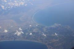 Взгляд земли, полей, и облаков сверху Стоковые Фото