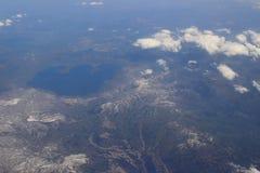 Взгляд земли, полей, и облаков сверху Стоковые Изображения