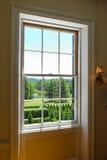 Взгляд имущества через окно Стоковые Фото
