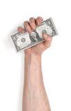 Взгляд конца-вверх руки человека держа банкноты одн-доллара, изолированный на белой предпосылке Стоковые Фотографии RF