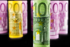 Взгляд крупного плана банкноты 100 свернутой евро Стоковая Фотография