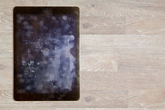 Взгляд отпечатков пальцев и тавота на экране таблетки Стоковые Изображения RF