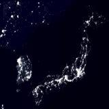 Взгляд от космоса на светах города Японии Поверхность земли от светящих частиц также вектор иллюстрации притяжки corel Стоковая Фотография RF