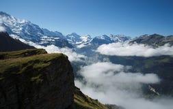 Взгляд от Mannlichen на Bernese Альпах (Berner Oberland, Швейцарии) Стоковые Изображения