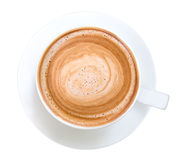 Взгляд сверху горячей пены спирали капучино кофе изолированной на белизне стоковая фотография rf