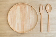 Взгляд сверху деревянных вилки и ложки плиты Стоковое Изображение