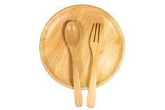 Взгляд сверху деревянных плиты, ложки и вилки на белой предпосылке Стоковые Фотографии RF