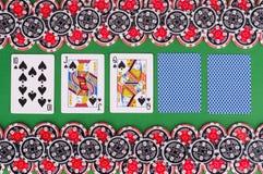 Взгляд сверху зеленой таблицы с 10, jack казино, ферзя, покрыло pl Стоковая Фотография
