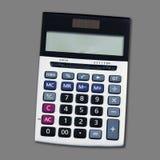 Взгляд сверху калькулятора изолированного на серой предпосылке Стоковая Фотография