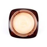 Взгляд сверху косметического cream опарника изолированного на белизне Стоковые Фото