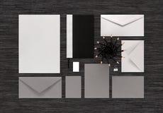 Взгляд сверху клеймя насмешки дела вверх на черной таблице Стоковое фото RF