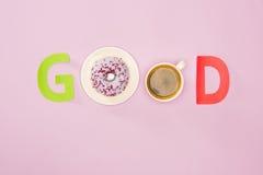 Взгляд сверху доброго слова сделанное от donuts и чашки кофе Стоковые Изображения RF