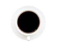 Взгляд сверху чашки черного кофе изолированной на белой предпосылке Стоковые Фото