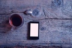 Взгляд сверху чая телефона Стоковые Изображения RF