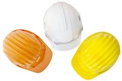Взгляд сверху multicolor safetyt, конструкции, шлема защиты стоковое фото rf