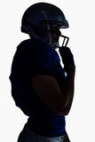 Взгляд со стороны шлема американского футболиста силуэта нося Стоковое фото RF