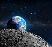 Взгляды земли от поверхности луны Стоковые Фотографии RF