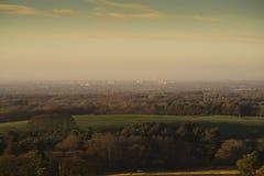 Взгляд Disley и Манчестер от Lyme паркуют, зимний день Stockport Чешира Англии Стоковые Фото