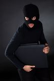 Взломщик на компьютере Стоковые Изображения