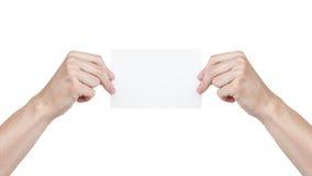 2 взрослых руки человека держа лист чистого листа бумаги Стоковая Фотография