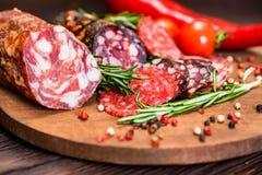 3 вида салями с томатами и перчинкой Стоковое Изображение