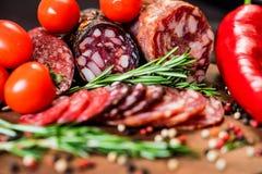 3 вида салями с томатами и перчинкой Стоковые Изображения