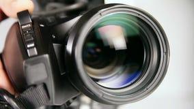 Видео- камкордер - близкий снимок объектива акции видеоматериалы