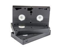 Видео- кассеты на белизне Стоковые Изображения RF