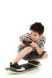 видео скейтборда игрока игры крытое Стоковая Фотография