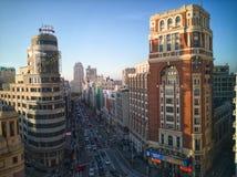 Виды с воздуха улицы Gran через в Мадрид на заходе солнца Стоковые Изображения