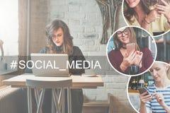 Вид спереди молодой коммерсантки сидя на таблице в кофейне и используя компьтер-книжку, около чашки кофе Стоковое Фото