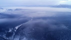Вид с воздуха в горе зимы восхода солнца акции видеоматериалы