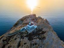 Вид с воздуха маяка Pietra и Genoese башни на заходе солнца Красный остров, Корсика, Франция Стоковые Фото