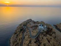 Вид с воздуха маяка Pietra на заходе солнца Красный остров, Корсика, Франция Стоковые Фото