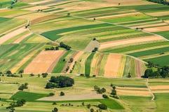 Вид с воздуха много полей Стоковые Изображения RF