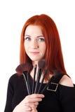 Визажист девушки с щетками Стоковая Фотография