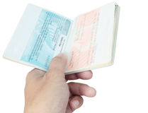 Виза и рука пасспорта Таиланда на белизне Стоковые Фото