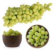 Виноградины в деревянном шаре изолированном на белизне Стоковое Фото