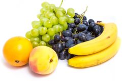 Виноградины, персики, бананы и апельсин Стоковое Изображение