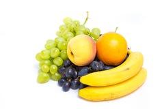 Виноградины, персики, бананы и апельсин Стоковая Фотография