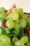Виноградины и арбуз стоковое изображение