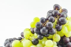 Виноградины и белая предпосылка стоковая фотография