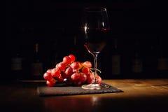 Виноградины и стекло вина Стоковая Фотография