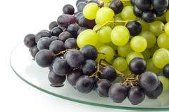 Виноградины на стеклянной пластинке стоковое изображение