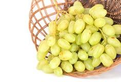 виноградины пука корзины предпосылки упрощают сторновку Стоковое фото RF