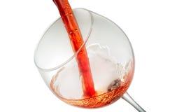 Вино брызгая на стекле Стоковые Изображения