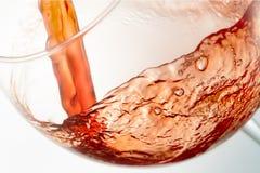 Вино брызгая на стекле Стоковые Фотографии RF