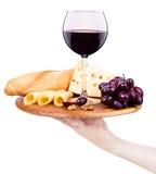 Вино и еда с рукой кельнера стоковое фото rf