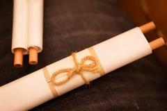 Винтажная бумага на предпосылке джинсов Стоковые Фото