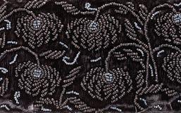 Винтажная вышивка черными шариками на черном бархате Стоковое Изображение